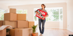 WOMAN-MOVING-HOUSE-